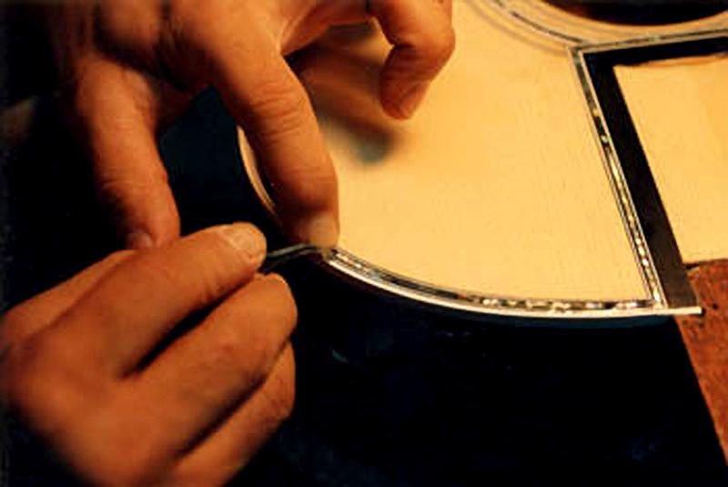 image of reparing guitar