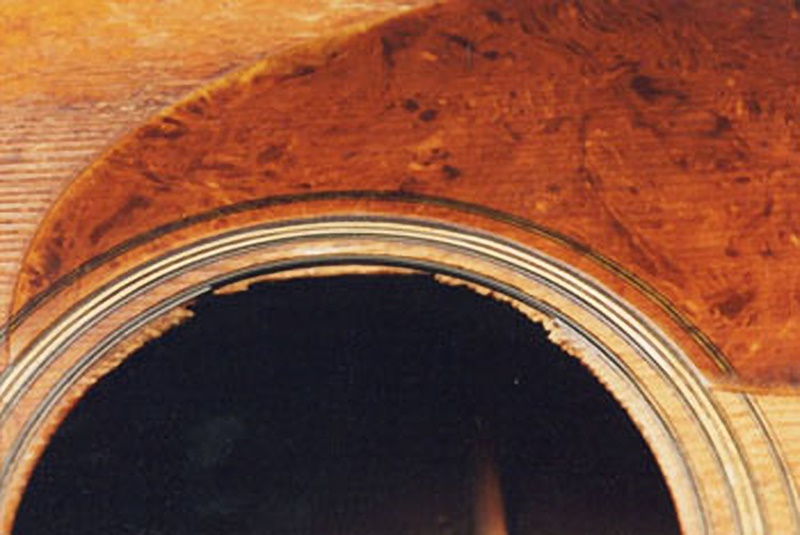 image of damaged sound hole