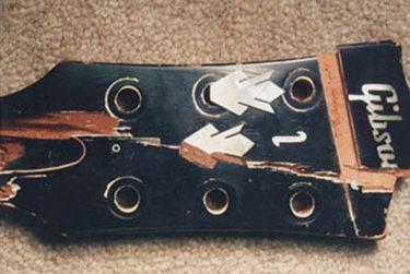 Broken headstock with broken Gibson logo
