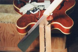 image of cutting the guitar neck
