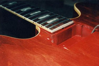Finished and polished guitar neck and pickup cavity