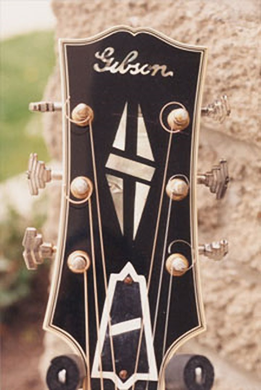 Restored headstock with new finish and binding