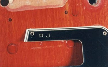 Engraved letters on the vintage guitar pickguard
