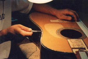 Saving the shell inlays of Martin D45 for reuse