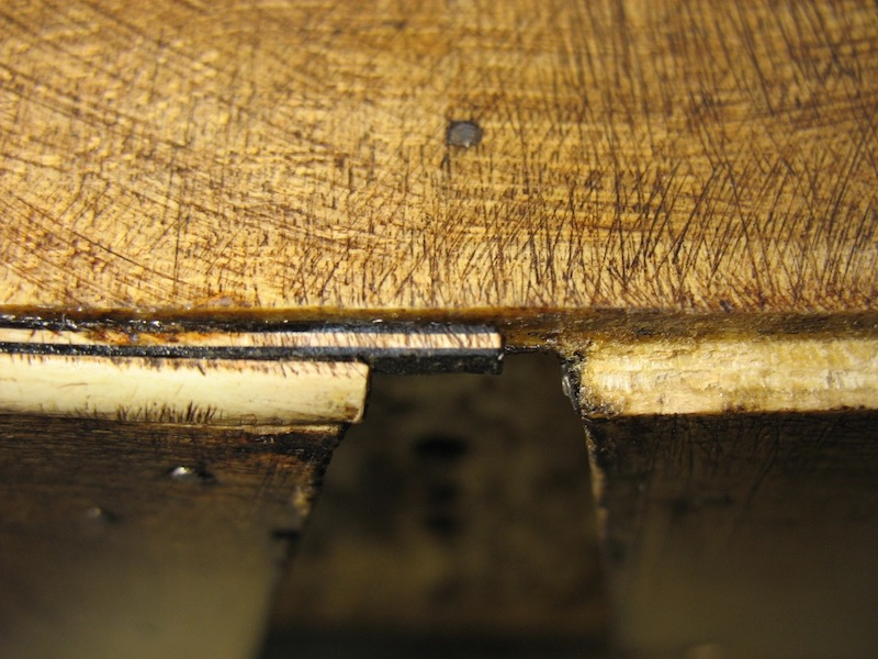 Rusty nail on the archtop guitar body