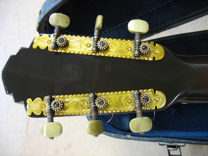 Restored headstock of vintage archtop guitar