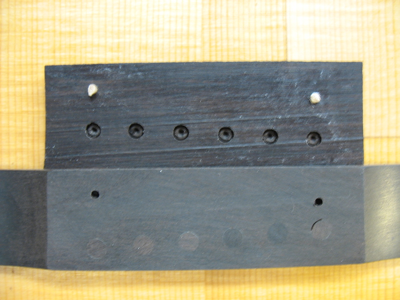 A new part of bridge with pin holes for left-handed