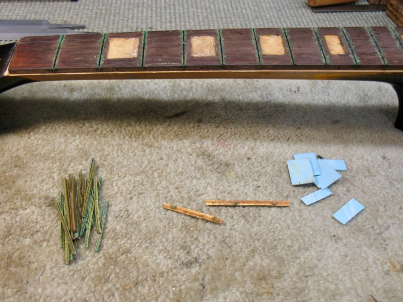 Frets, bindings, and inlays on the Gretsch fingerboard were removed to replace