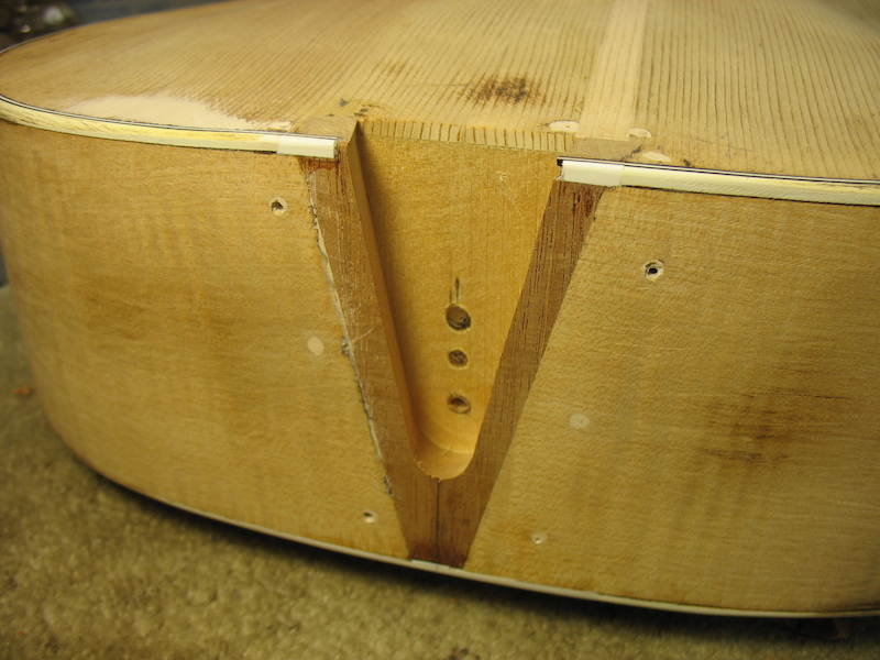 The female part of the dovetail neck joint