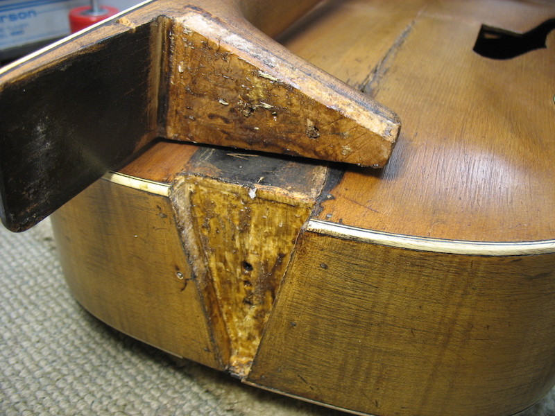 The neck joint of vintage archtop guitar - before repair