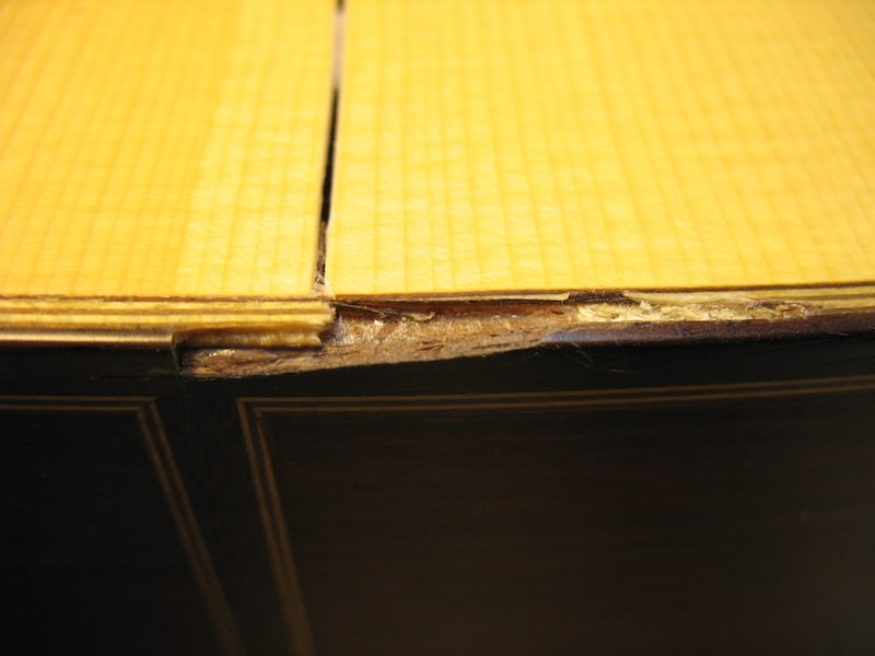 A part of binding and bottom of classical guitar is damaged
